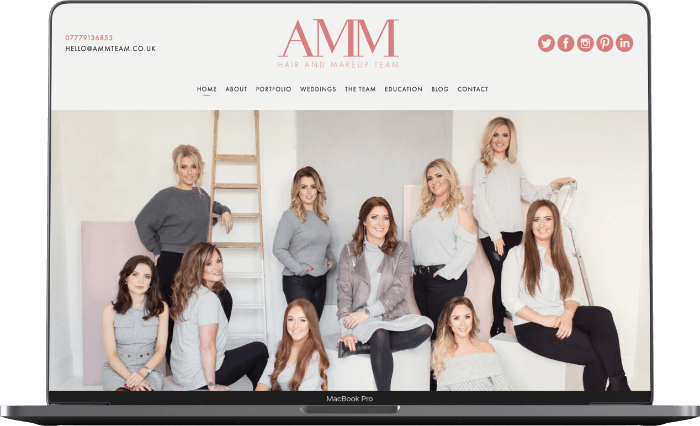 Image of AMM Team website on MacBook