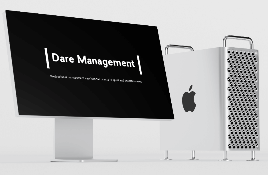 The latest Mac with the Dare Management website on the screen
