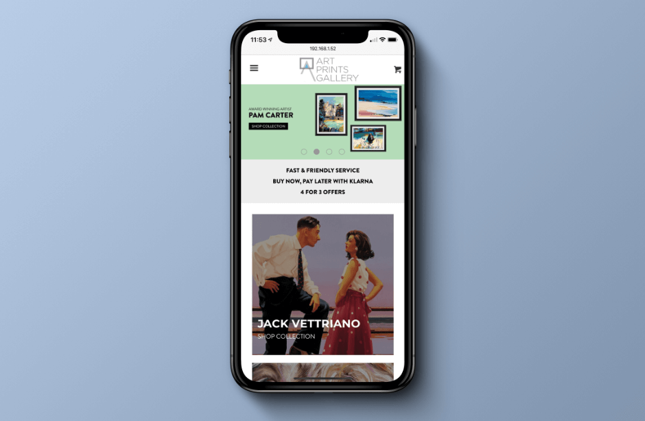 iPhone XS with Art Prints Gallery website on the screen