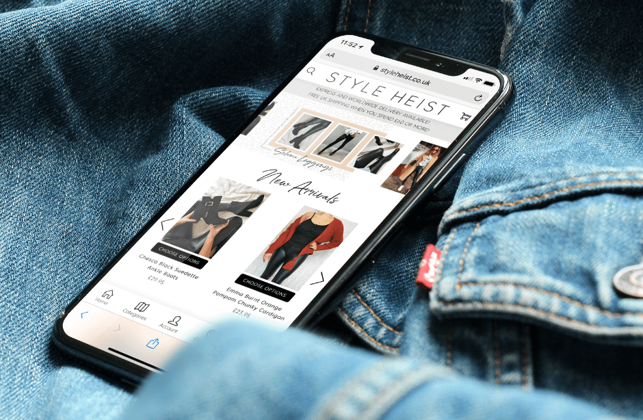 iPhone on top of denim jacket