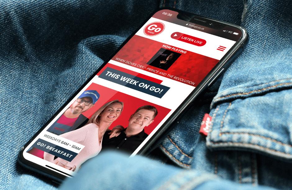 Go Radio website on phone lying on top of denim jacket