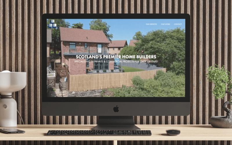Mac screen with Ralston Builders website